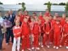 Tennisjeugd en BTOtrainers in trainingspak